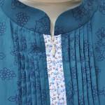 Bukaan depan produk baju Haifa menggunakan resleting jepang